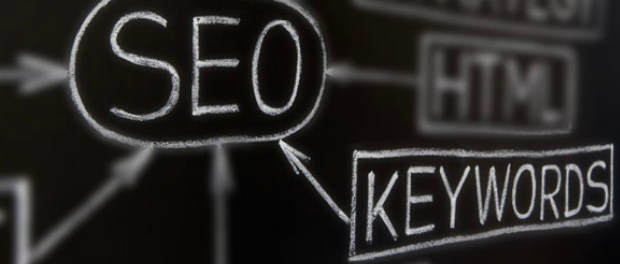 """A blackboard with a brainstorm containing """"SEO"""" in the middle and """"keyword"""" linked to it. Implying that your Keyword Planner is essential to your SEO efforts"""